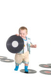 Little baby boy holding a vinyl disk Royalty Free Stock Images