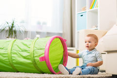 Little baby boy at home in a room in the interior Royalty Free Stock Photography