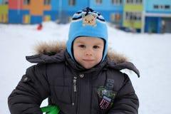 Little baby boy joyful walks in winter outside playing royalty free stock photo