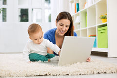 Little baby boy learn how to playing computer Royalty Free Stock Photos
