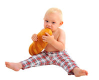 Little baby boy with loaf, isolated on white background Royalty Free Stock Photo