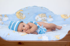 Little baby boy lying in bed Stock Image