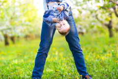 Little baby boy with mother in the blossoming garden Royalty Free Stock Image
