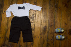 Little baby boy outfit for party on grunge wood background with copy space Royalty Free Stock Images