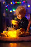 Little baby boy playing with illuminated toys Stock Photos