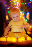Little baby boy playing with illuminated toys Stock Images