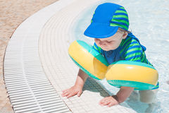 Little baby boy playing in the pool Royalty Free Stock Image