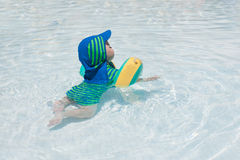 Little baby boy playing in the pool Royalty Free Stock Photo