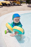 Little baby boy playing in the pool Royalty Free Stock Photography