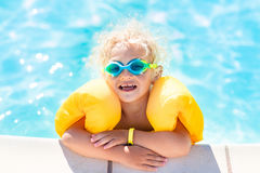 Little baby boy playing in swimming pool Stock Image