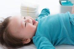 Baby boy preparing for a diaper change. Little baby boy preparing for a diaper change stock photography