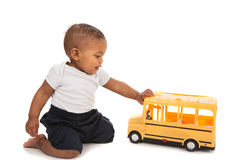 Little Baby Boy Pushing Toy School Bus Royalty Free Stock Photos