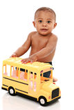 Little Baby Boy Pushing Toy School Bus Stock Photo
