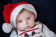 Little baby boy in red Christmas cap Royalty Free Stock Image