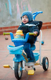 LIttle baby boy riding a bike, smiling Royalty Free Stock Photo