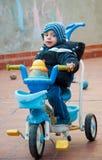 LIttle baby boy riding a bike, smiling Royalty Free Stock Photo