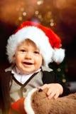 Santa baby with santa hat smiling royalty free stock photo