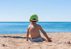 Little baby boy sitting  playing with the sand Royalty Free Stock Images