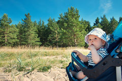 Little baby boy sitting in the stroller on summer day Royalty Free Stock Image