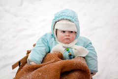 Little baby boy in sledge on winter snow day Royalty Free Stock Photography