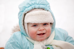 Little baby boy in sledge on winter snow day Stock Images