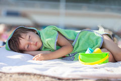 Little baby boy, sleeping on the beach in the afternoon Royalty Free Stock Photography