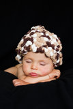 Little baby boy, sleeping. With hat on a black background Royalty Free Stock Images