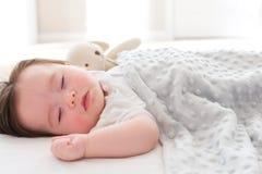 Little baby boy sleeping. In his house Stock Photos