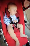 Little baby boy in a stroller Royalty Free Stock Photos
