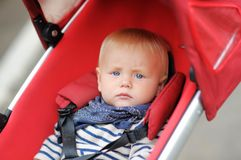 Little baby boy in stroller Stock Image