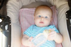 Little baby boy in stroller at summer day Royalty Free Stock Photos