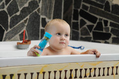 Little baby boy taking a bath playing Stock Photo
