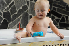 Little baby boy taking a bath playing Royalty Free Stock Photo