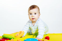 Little baby boy with toys Stock Images