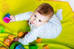 Little baby boy with toys Stock Photo