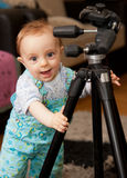 Little baby boy and tripod Royalty Free Stock Photo