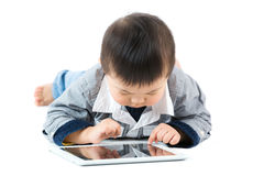 Little baby boy using tablet Stock Photos