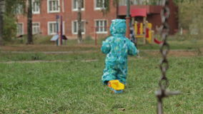 Little baby boy walking away in playground. HD stock footage