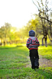 Little baby boy walking away - sunset colors Royalty Free Stock Photo