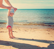 Little baby boy walking on the beach in summer day Royalty Free Stock Images