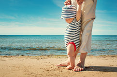 Little baby boy walking on the beach in summer day Royalty Free Stock Photography