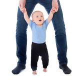 Little baby boy walking with father isolated on white Stock Photography