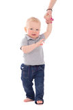 Little baby boy walking and holding mother's hand isolated on wh Royalty Free Stock Photos