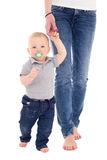 Little baby boy walking with mother isolated on white Stock Images