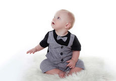 Little baby boy wearing in gentleman suit sitting over white Royalty Free Stock Image