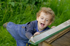 Little baby boy wearing jeans outdoor Royalty Free Stock Images