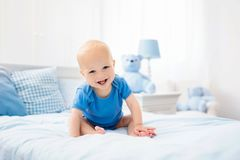 Little baby boy on white bed Stock Photography