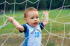 Little baby boy winner playing sport  game. Little baby boy winner playing sport football game Royalty Free Stock Photos