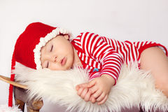 Little baby boys, sleeping on a sledge Stock Images