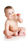Little baby brushing gums over white background Royalty Free Stock Photography